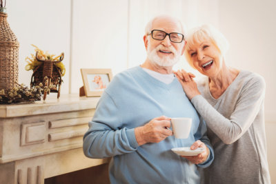elderly wife feeling extremely happy while standing near her caring man