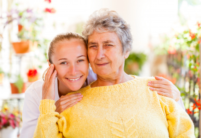 woman and elder woman smiling