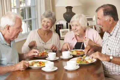 group of senior having meal
